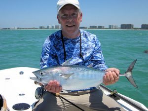 Mark Nielsen, from Seaford, DE, with his first false albacore (little tunny) caught and released on a fly while fishing the coastal gulf with Capt. Rick Grassett in a previous May.