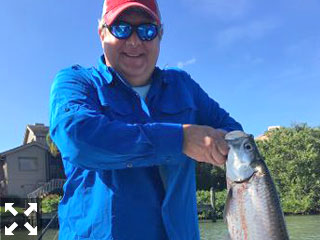 John Hoeksema shows off this small tarpon he caught and released this past week.