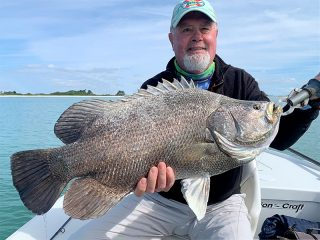 Jeff Hanna, from Englewood, FL, with a 15-lb tripletail caught on a fly while fishing with Capt. Rick Grassett.
