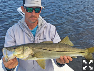 Capt. Brian Boehm with a nice looking snook.