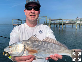Brian Nafzinger, from Rehoboth, DE, with a red caught and released on a CAL jig with a shad tail while fishing Little Sarasota Bay with Capt. Rick Grassett.