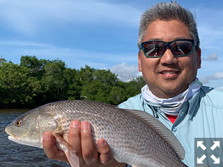 Dave from Colorado with a nice looking backcountry redfish caught on a fly.