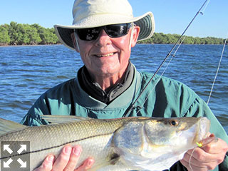Keith McClintock, from Lake Forest, IL, with a nice snook caught and released on a CAL jig with a shad tail while fishing shallow water with Capt. Rick Grassett in a previous January.