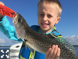 Five year old Michael Bell was all smiles after catching this nice speckled trout.