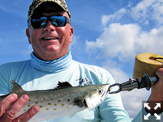 Bill Rohm, from Cleveland, with a Spanish mackerel caught and released on a fly while fishing deep grass with Capt. Rick Grassett recently.