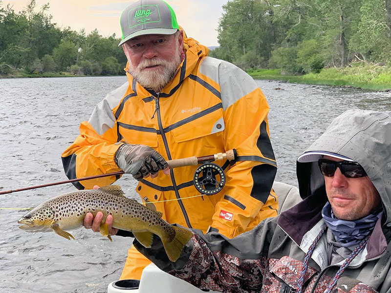 Capt. Rick Grassett, from Sarasota, FL, with a brown trout caught and released on a fly while fishing with and guide Dan Allen, out of King Outfitters in Dillon, MT.