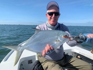 Marshall Dinerman, from Lido Key, had good action with this pompano on CAL jigs with shad tails while fishing Sarasota Bay with Capt. Rick Grassett in a previous November.