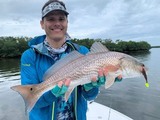 You might find reds in potholes or along the edges of flats and bars on negative low tides.