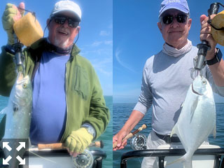 Bill Morrison with a Sarasota Bay bluefish caught on a Clouser fly and Alan Sugar with a Pompano caught and released on a Clouser fly while fishing Sarasota Bay.
