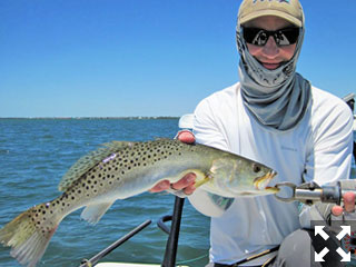 There should be good action with trout and more on deep grass flats during April. Matt Schenk, from CO, caught and released this trout on a fly while fishing Sarasota Bay with Capt. Rick Grassett in a previous April.