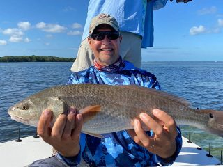 That's one nice looking Redfish, and one happy Angler.
