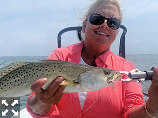 Susan Wayde, from Bloomfield Hills, MI, with a nice trout caught and released on a Clouser fly while fishing Sarasota Bay with Capt. Rick Grassett recently.