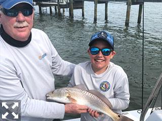 Jonah proudly displaying his 23 inch Redfish.
