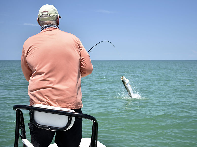 Clark Keator, from Orlando, fights a tarpon on fly tackle while fishing the coastal gulf with Capt. Rick Grassett in a previous June.