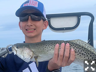 Connor Pullum, from Hayesville, NC, with a nice trout caught and released on a DOA Deadly Combo while fishing Sarasota Bay with Capt. Rick Grassett recently.