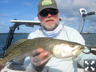 There should be good action in shallow water early in the day in July. Capt. Rick Grassett caught and released this trout on a DOA Deadly Combo while fishing Sarasota Bay in a previous July.