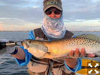 Ken Babineau had some great trout action while fishing at first light with Capt. Grassett in a previous August.