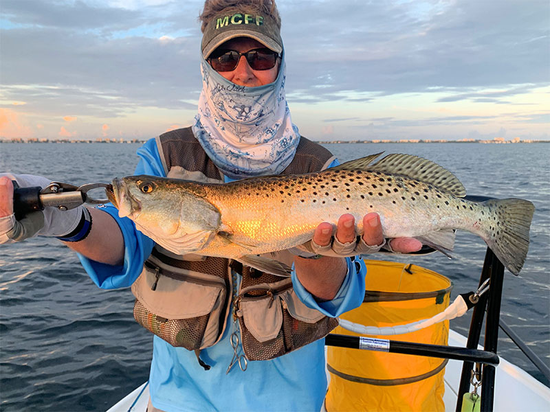 Ken Babineau, at first light, had some great trout action while fishing with Capt. Rick Grassett in a previous August.