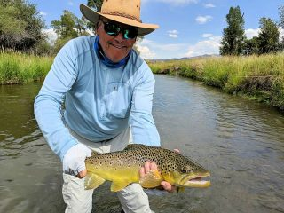Dennis Kinley, from IN, with a nice brown trout caught and released on a fly while fishing with King Outfitters out of Dillon, MT recently.