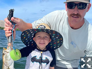 The warm waters of Sarasota Bay look pretty good to these father and son Wisconsin natives.