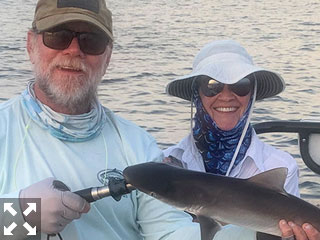 Pat Beckwith, from Sarasota, with a shark caught and released on a Clouser fly while fishing Sarasota Bay with Capt. Rick Grassett recently.