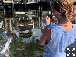 Gianna Tornabene having 'fun, fun, fun' with her dad fishing Sarasota Bay.