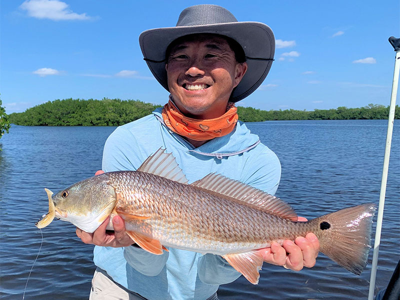 Jon Yenari, from Sarasota, had good action with reds on CAL jigs with shad tails while fishing Gasparilla Sound with Capt. Rick Grassett in a previous October.